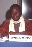 ritratto di Mamadou Sarr (Burkina Faso), presumibilmente nel corso di un'assemblea del Consiglio Federale del PR.