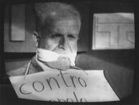 """Foto scattata davanti alla televisione. Mellini  imbavagliato con cartello al collo: """"contro..."""" Si tratta della famosa Tribuna sul referendum (legge"""