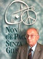 ritratto di Stanzani (presidente di NPWJ) con il simbolo di npwj