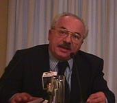 Ritratto (a mezzo busto, seduto) di Teodoro Buontempo (Alleanza Nazionale), relatore al Convegno Pedofilia e Internet, promosso dal Partito Radicale e