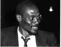 Ritratto di Basile Guissou, già ministro degli esteri del Burkina Faso, di tre quarti, sorridente. Ottimo. 3835bis: primo piano di Guissou sorridente