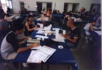 Operazione di pulitura delle firme presso il salone dell'Hotel Ergife.  Vari lavoratori interinali, e, fra i coordinatori, nelle altre foto, Gabriele