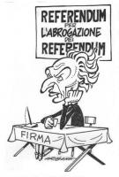 """Marco Pannella - espressione accigliata - siede a un banchetto per la raccolta di firme, sotto un cartello: """"Referendum per l'abrogazione dei referend"""