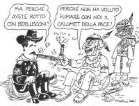 VIGNETTA Marco Pannella, in abiti da pellerossa, offre una pipa a Massimo D'Alema, in una divisa militare recante lo stemma di falce e martello. D'Ale