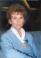 Emma Bonino, a una tribuna elettorale, con la spilla della lista Marco Pannella.