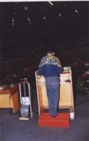 38° Congresso, II sessione: Alla tribuna, di spalle: Lucio Berté (consigliere radicale della Regione Lombardia).  (La catena al polso è un'iniziativa