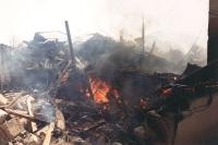 Scena di guerra. Un ammasso di ferraglia e rovine, risultato di un incendio.