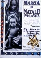 Fotografia del manifesto della marcia di Natale contro lo sterminio per fame.
