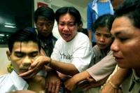Chea Vichea (a sinistra) sindacalista dei lavoratori del settore tessile, ucciso da tre proiettili. (Photo: Reuters).